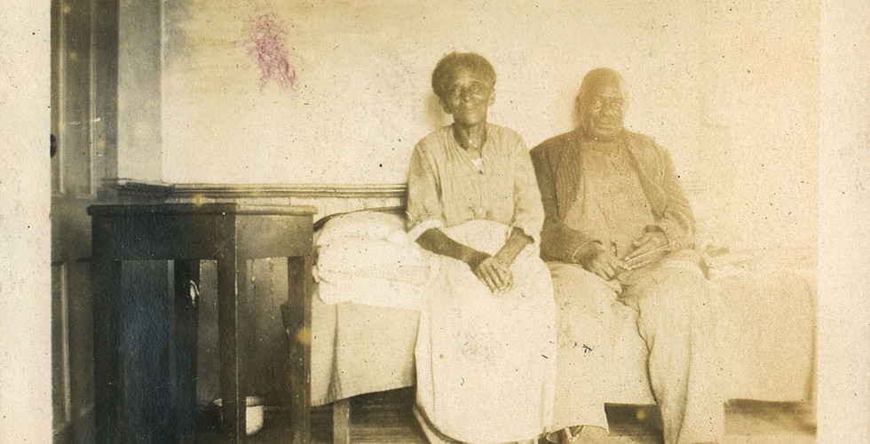 Sally and Alec in the kitchen, c. 1920