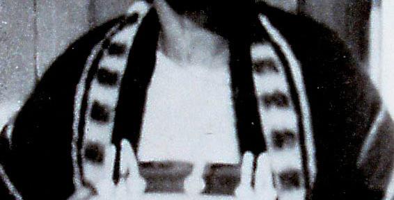 Sally Turner holding Alec's birthday cake, c August 10, 1922