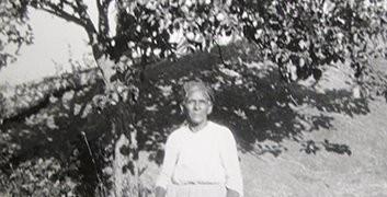 Sally Turner by her favorite apple tree on Turner Hill